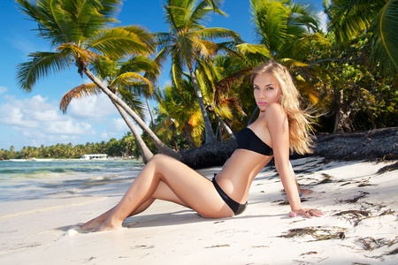 dominican republic: Girl in bikini on caribbean beach, Dominican Republic