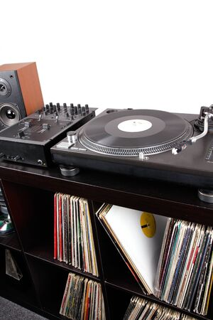 Turntable, mixer and loudspeaker on black table, closeup  photo