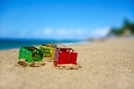 New year present boxes on tropical beach photo