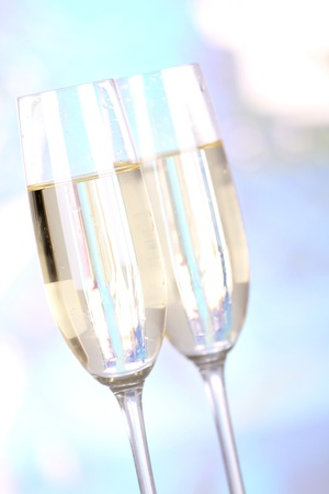 Two glasses of champagne on blur background photo