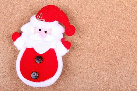 Santa Claus toy on board photo