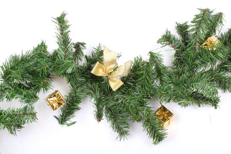 New year firtree branch with present bags, closeup on white photo