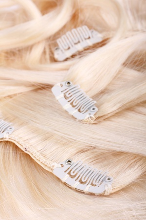 Blond hair extension, clips details Stock Photo