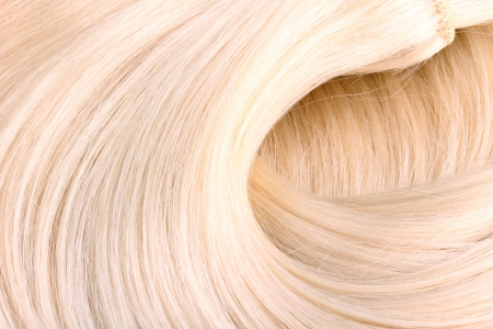 Blond hair extension macro photo
