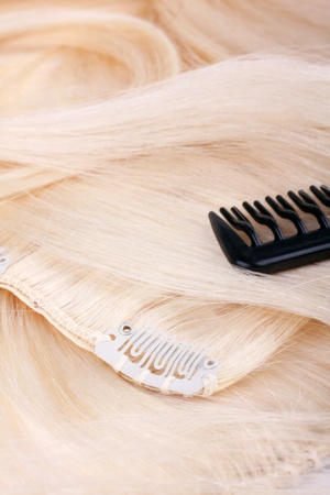 Hair extensions, clips and brush photo