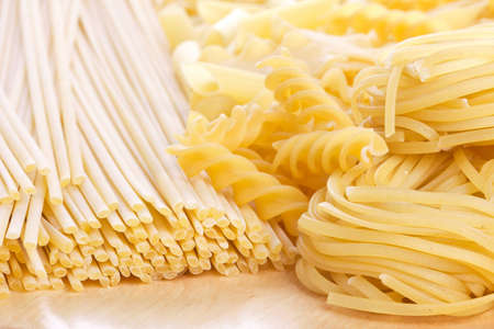 Tagliatelle, spirals and spaghetti, closeup shot photo