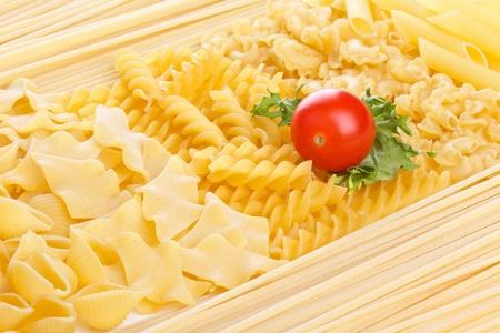 Tomato on different macarons background, closeup shot Stock Photo - 12767076