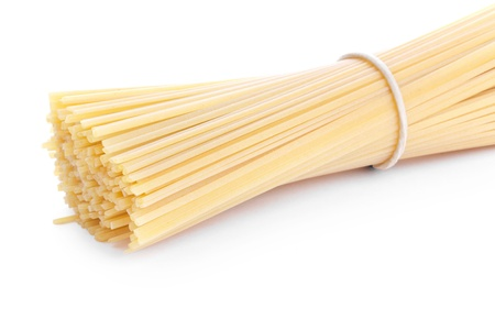 Spaghetti bunch closeup on white photo