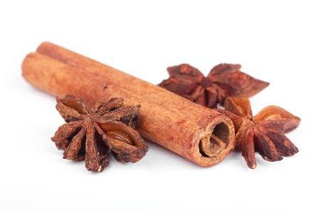 Cinnamon and anise , ingredients for preparation mulled wine, isolated on white photo