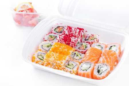 Sushi and roll assortment in box, closeup on white photo