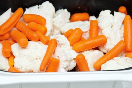 Carrots and cabbage in steam cooker photo