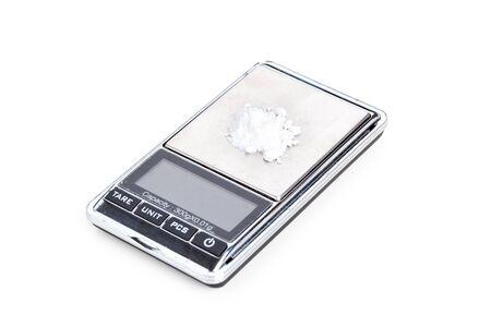 Cocaine on digital scales, closeup on white Stock Photo - 12948396