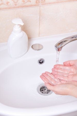 Woman washing hands in bathroom close up Stock Photo - 12948522