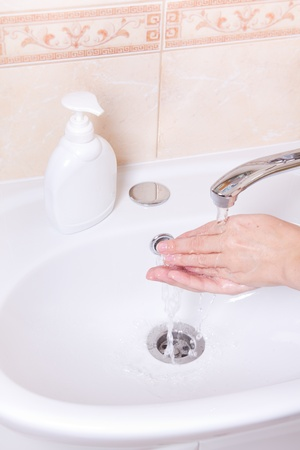 Woman washing hands in bathroom close up Stock Photo - 13175546
