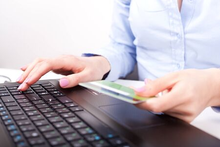Business woman typing and making online payment with credit card  photo