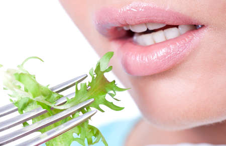 Woman eating fresh organic salad , closeup photo