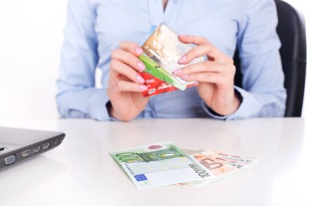 mastercard: Euro banknotes сloseup and credit cards in business woman hands, sitting in office
