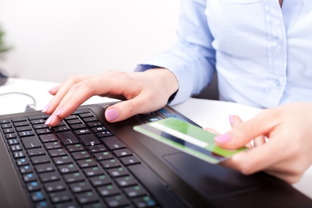 Business woman typing and making online payment with credit card