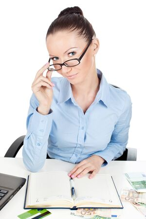 batch of euro: Business woman in glasses on workplace  Stock Photo
