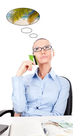 Business woman on workplace with card in hand , dreaming about caribbean vacation Stock Photo - 13175614
