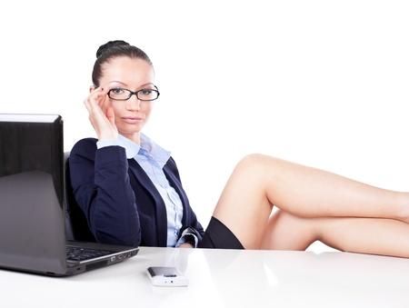 Flirting business woman on workplace photo