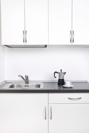 Percolator and one cup of coffee on worktop, kitchen interior Stock Photo