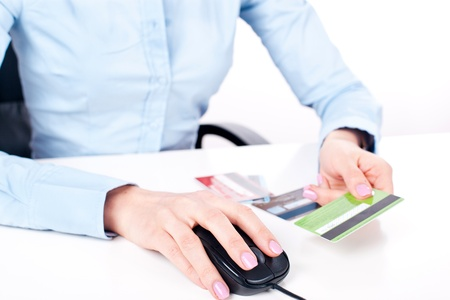 Shopping on-line, female hands holding credit card, closeup photo
