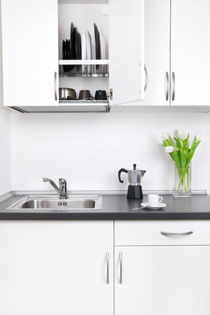Kitchen interior, cup of coffee, percolator and tulips on worktop Stock Photo - 14040016