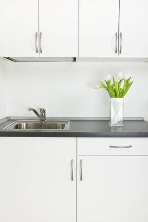 Kitchen inter, tulips in vase on worktop Stock Photo - 14040160