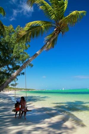 Seesaw on palm on caribbean sea beach photo