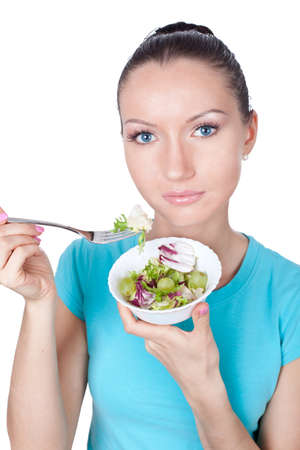 Woman eating vegetarian salad, closeup portrait photo
