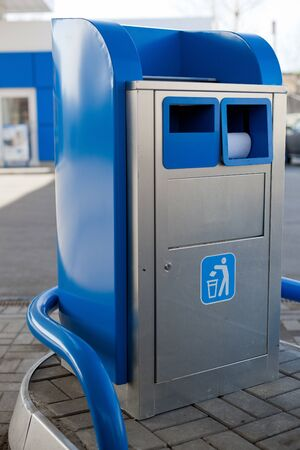 Blue garbage can on gas station photo