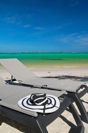 Sun hat on beach chaise longues,  closeup photo