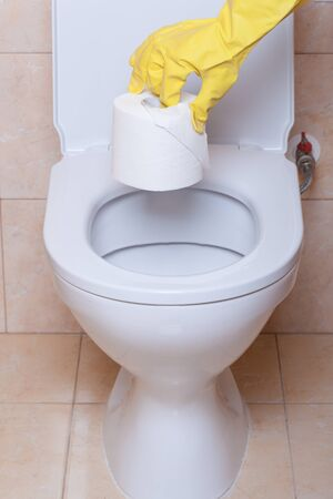 WC hygiene concept, hand in yellow glove making signs photo