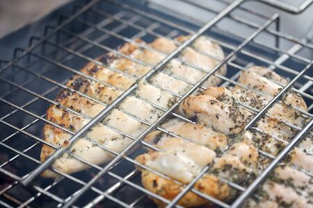 metal grate: Barbecue with chicken in metal grate, closeup  Stock Photo
