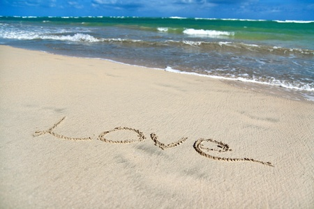Sign Love on sand on caribbean beach, Dominican Republic photo
