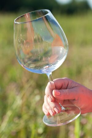 Empty wineglass, outdoor photo
