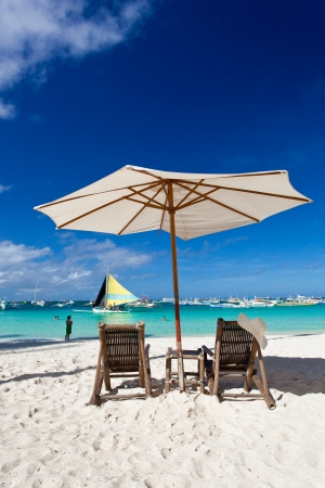 Sun umbrella with Sun Hat on chair longue  photo