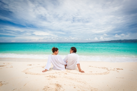 Young loving couple on beach, enjoying each other photo