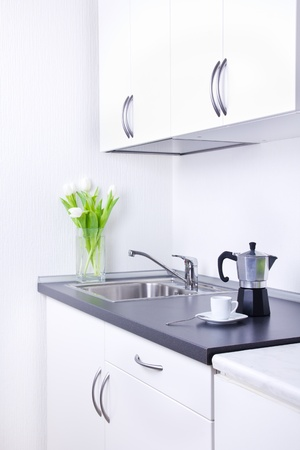percolator: Percolator and one cup of coffee on worktop, kitchen interior Stock Photo