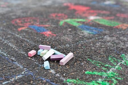Colorful chalks on asphalt, child drawing photo