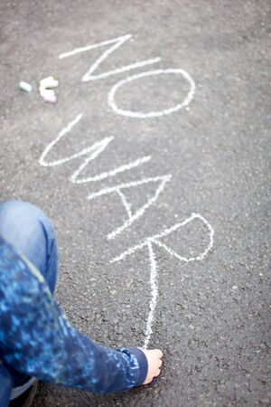 Child handwriting by chalk - NO WAR photo