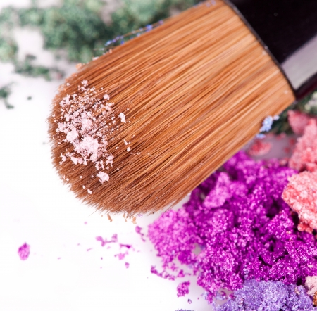 Crumbled eyeshadows with brush  Macro photo