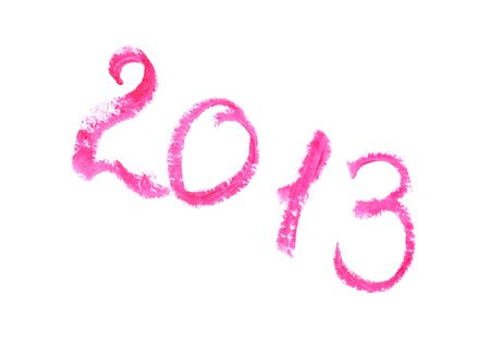 2013 written with lipstick Isolated on white background photo