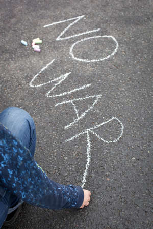 no war: Child handwriting by chalk - NO WAR