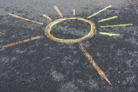 sun drawing on asphalt  by chalks photo