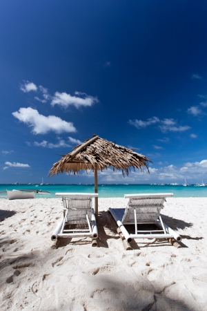 Sun umbrella with chair longues on tropical beach,  Boracay photo