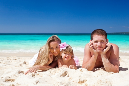 Happy family having fun on tropic vacation photo