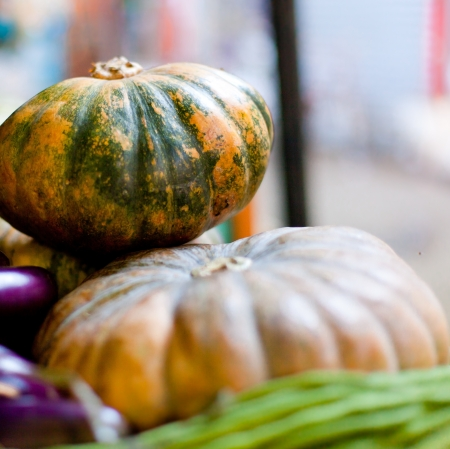 pit fall: Green pumpkins on asian market Stock Photo