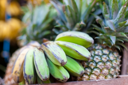 Bananas and pineapples on asian market photo
